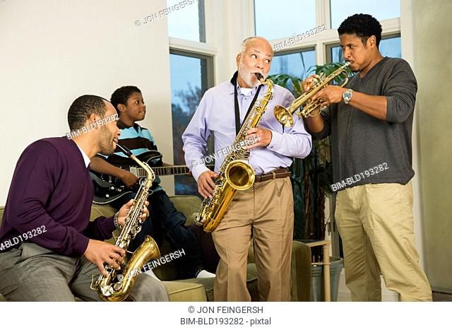 African American family playing saxophone together