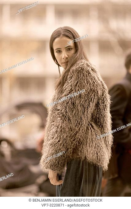 fashionable model woman walking in city, in Munich, Germany