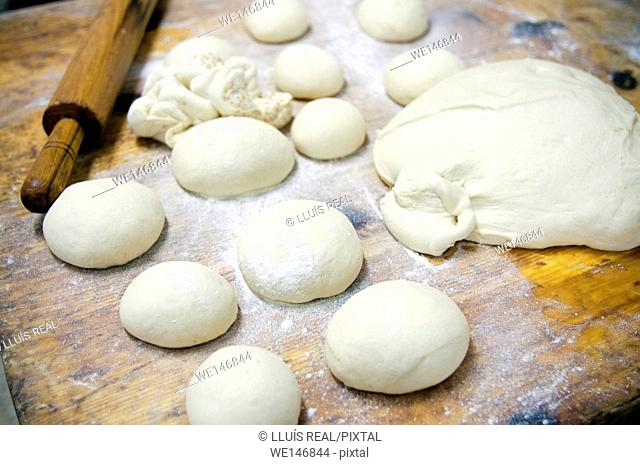 bread dough balls and roll in a desk in a bakery