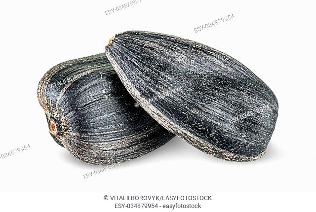 Two pieces of sunflower seeds on each other isolated on white background