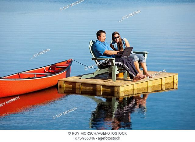 couple on dock with canoe