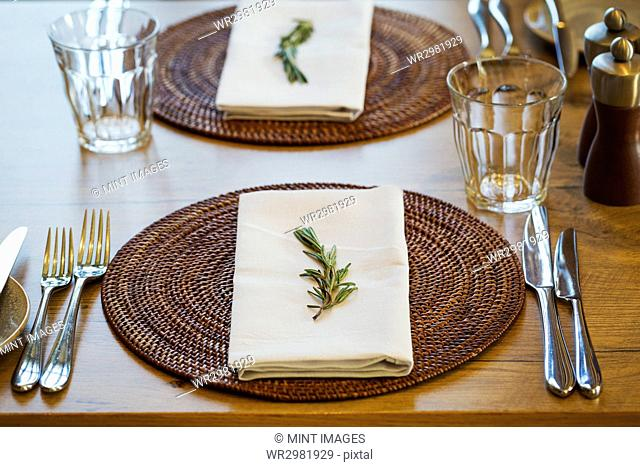 Close up of a table setting with place mat, napkin and cutlery at a hotel
