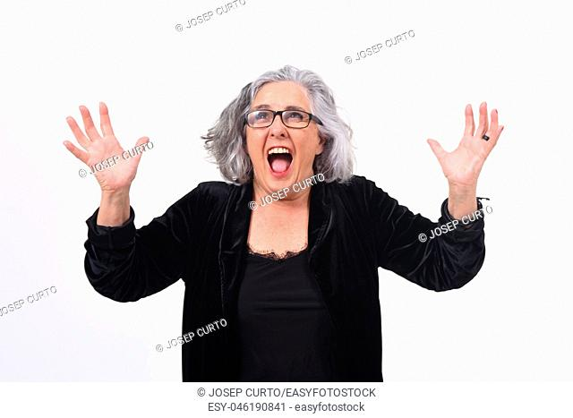 woman raising her arms and smiling in victory sign on white background
