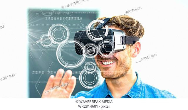 Digital composite image of smiling man using VR glasses