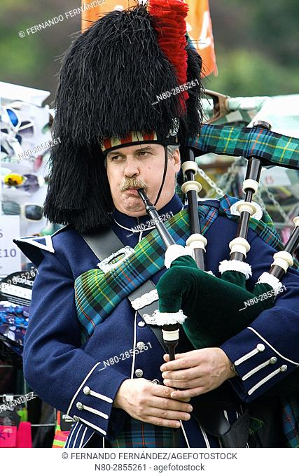 A marching pipe band performing at Highland Games. Aboyne. Aberdeenshire. Scotland. Europe