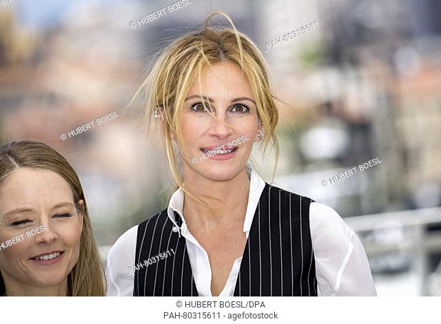 Director Jodie Foster (l) and Julia Roberts attend the photocall of Money Monster during the 69th Annual Cannes Film Festival at Palais des Festivals in Cannes