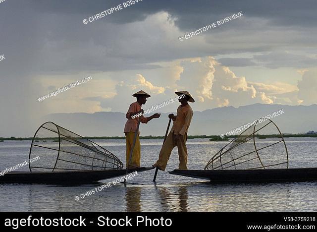 Myanmar, Shan State, Inle Lake, Intha fishermen chatting