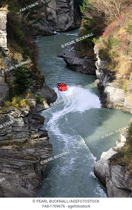 Arthurs Point Queenstown South Island New Zealand  View down into the Shotover River canyon with jet boat giving rides