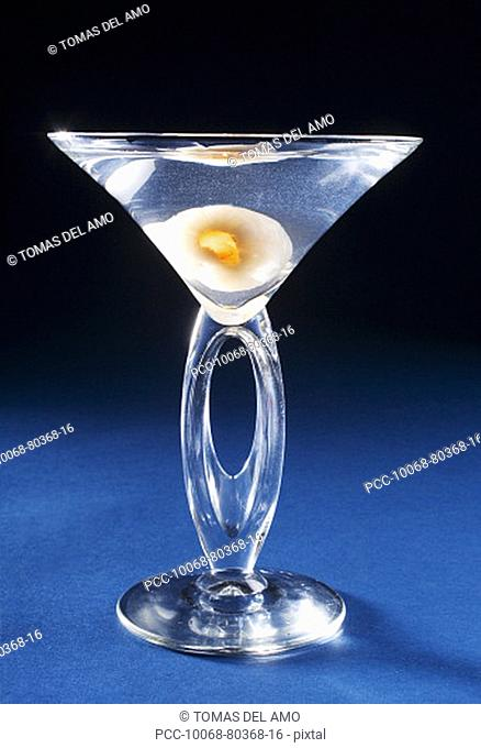 A lychee martini on a blue background