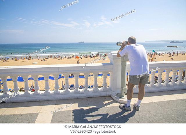 Man at the viewpoint over the beach. El Sardinero, Santander, Spain