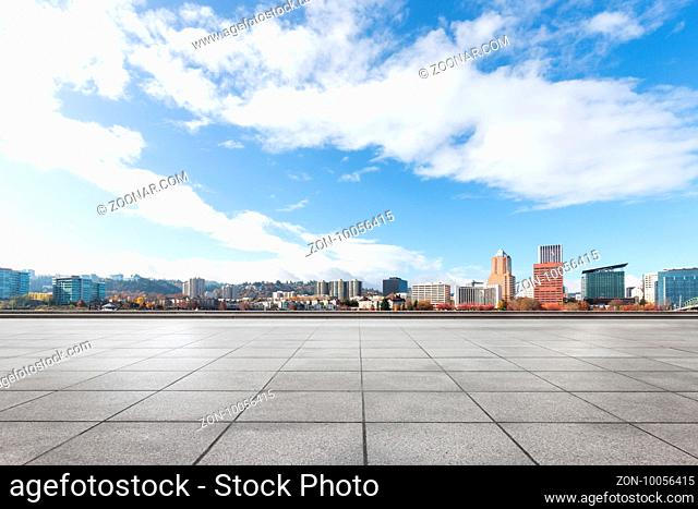 cityscape and skyline of portland from empty brick floor
