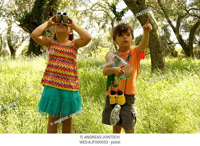 Greece, Ionic Islands, Corfu, boy and girl exploring the wilderness