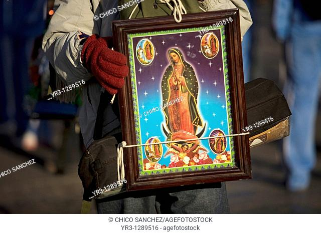 A pilgrim carries an image of the Our Lady of Guadalupe outside of the Our Lady of Guadalupe Basilica in Mexico City, December 11