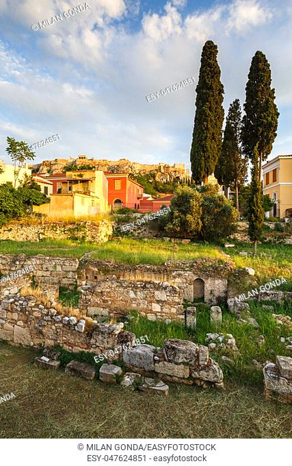 View of the Acropolis over the remains of ancient Greek Agora and neoclassical buildings of Plaka in central Athens, Greece.