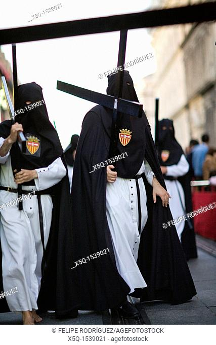 Hooded penitents bearing wooden crosses, Holy Week 2008, Seville, Spain