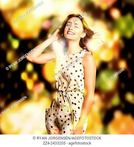 Retro disco portrait of a beautiful brunette woman dancing in a haze of bright colourful neon lights. . Nightclub dance floor pinup
