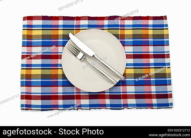 Plate and utensils served on table