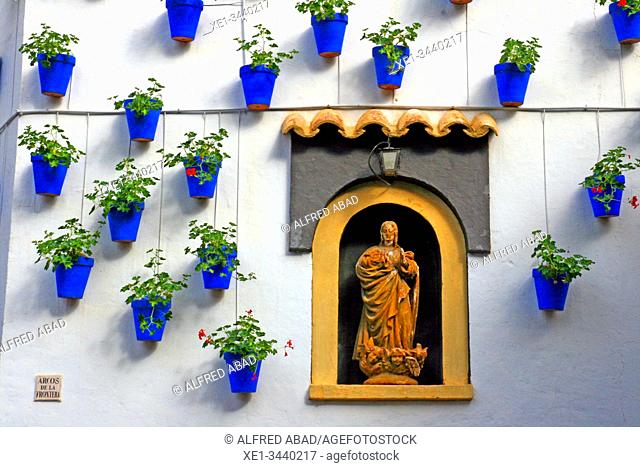 religious image and pots on the wall, Andalusian neighborhood, architectural ensemble of Poble Espanyol, Barcelona, ??Catalonia, Spain