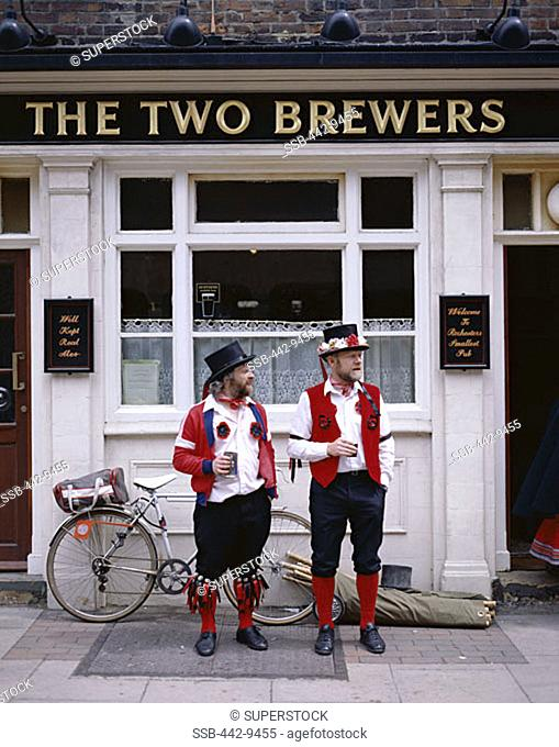 Two Morris Dancers Drinking Outside Pub, Rochester, Kent, England
