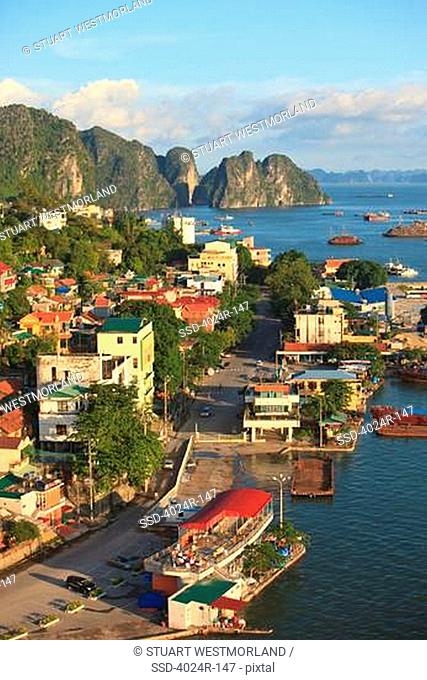 Coastal city with cliffs viewed from Bai Chay Bridge, Halong Bay, Vietnam