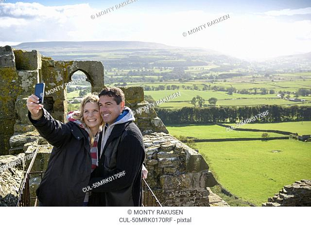 Couple taking picture on medieval ruins