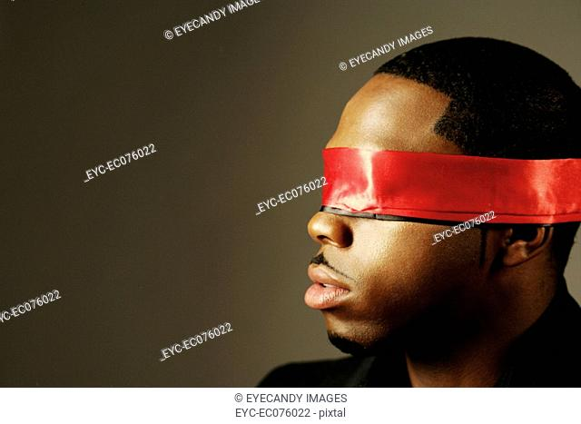Young African American man blindfolded