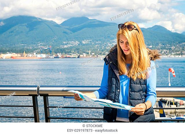 Beautiful girl looking at the map of the city
