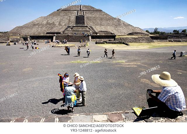 "Vendors and tourists stand outside the Pyramid of the Sun in Teotihuacan, Mexico City. Teotihuacan that means ""City of the Gods' and was founded by the..."