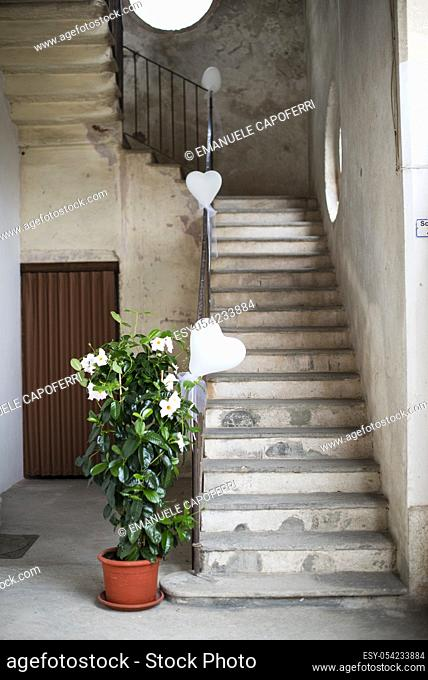Stairs in a home decorated for marriage ceremony