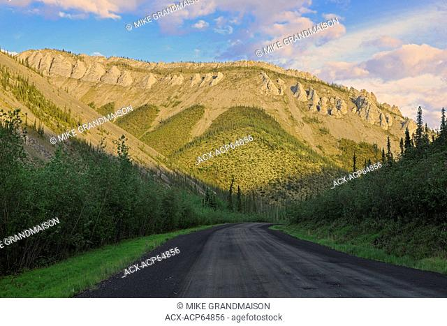 Dempster Highway, gravel road, at sunset, Dempster Highway, Yukon, Canada