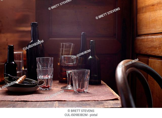 Beer bottles and glasses on table
