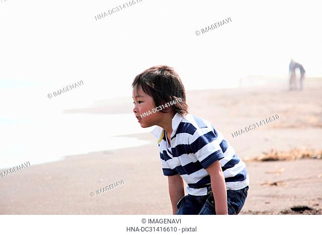 Child playing at sea