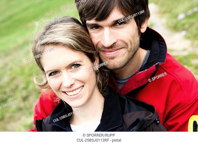 Man hugging girlfriend close-up