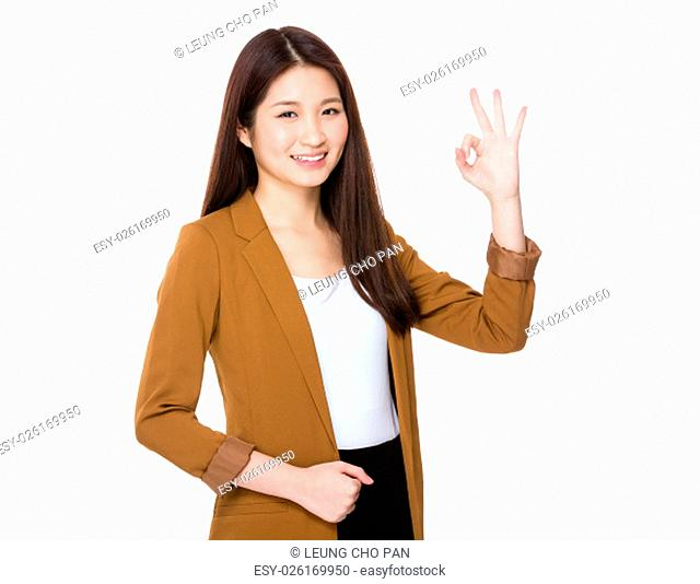 Asian young businesswoman with ok sign gesture