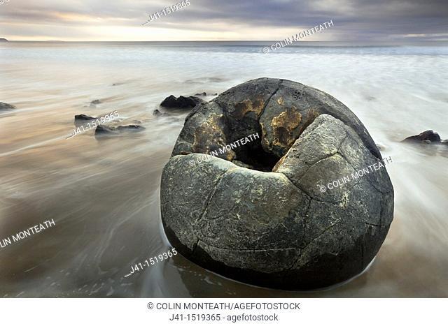 Moeraki boulder, sombre winter dawn, near Oamaru, Otago, South Island, New Zealand