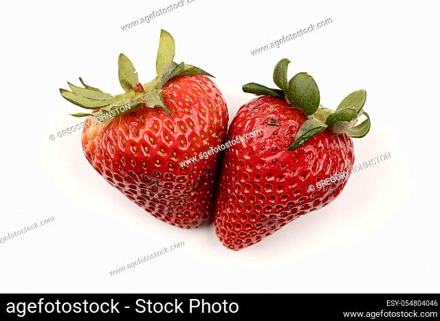 Two delicious and fresh strawberries are on a pure white background