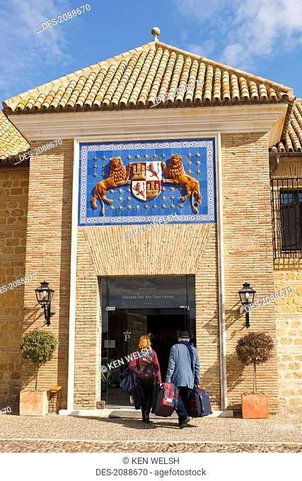 Coat of arms of pedro i the cruel king of castille above main entrance of parador alcazar del rey don pedro, carmona seville province spain