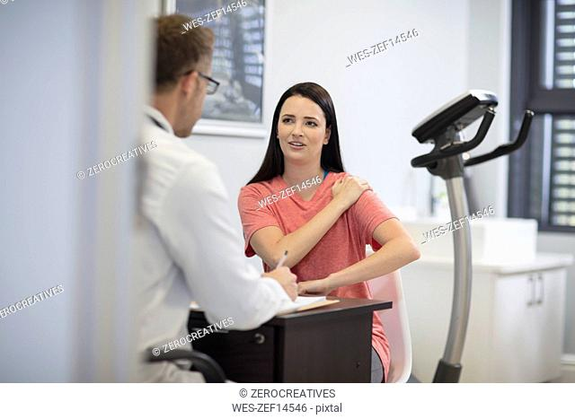 Patient talking to doctor in medical practice