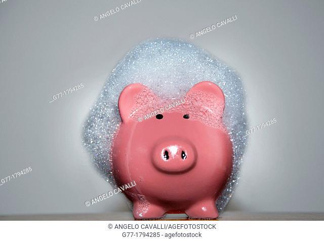 Piggybank in soap foam