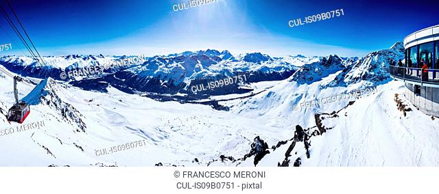 Panoramic view of ski lift in snow covered mountains, Sankt Moritz, Engadin, Switzerland