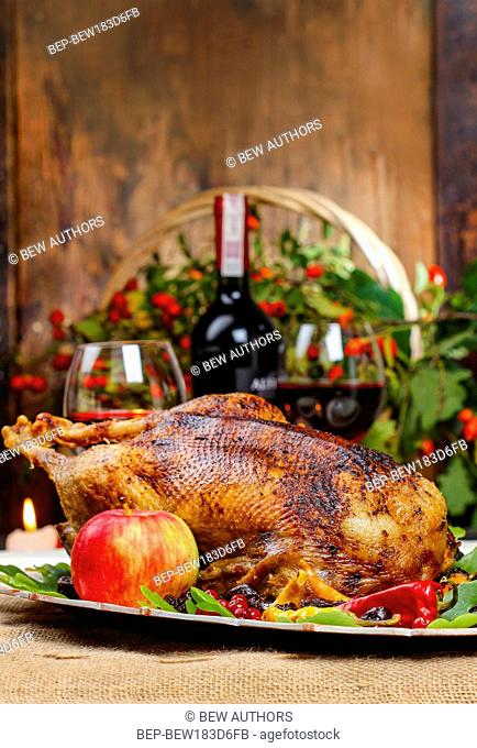 Roasted goose on wooden table. Popular christmas dish