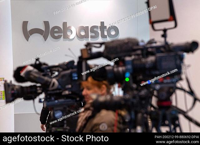 12 February 2020, Bavaria, Gauting: Journalists are waiting in the foyer of Webasto for a press statement from the CEO. The automotive supplier has reopened its...