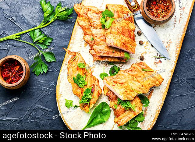 Appetizing pork meat or smoked pork ribs