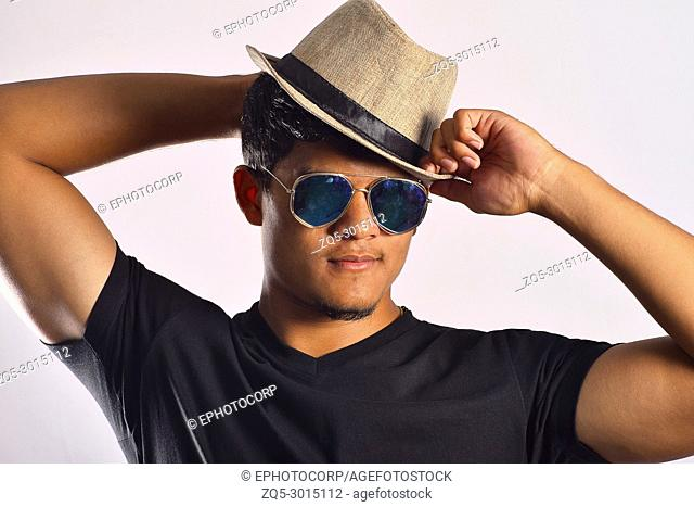 Young man in casual dress and hat, Pune, Maharashtra