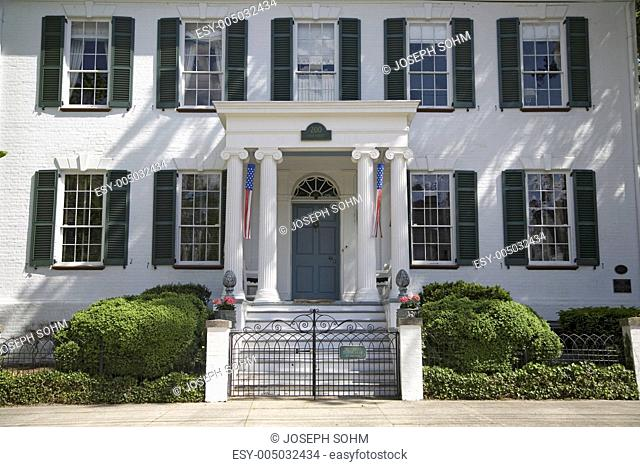 Green shutters on a white house in Pocomoke City, the Eastern Shore of Maryland