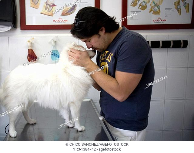 A man kisses his dog at a Pet Hospital in Condesa, Mexico City, Mexico, February 23, 2011