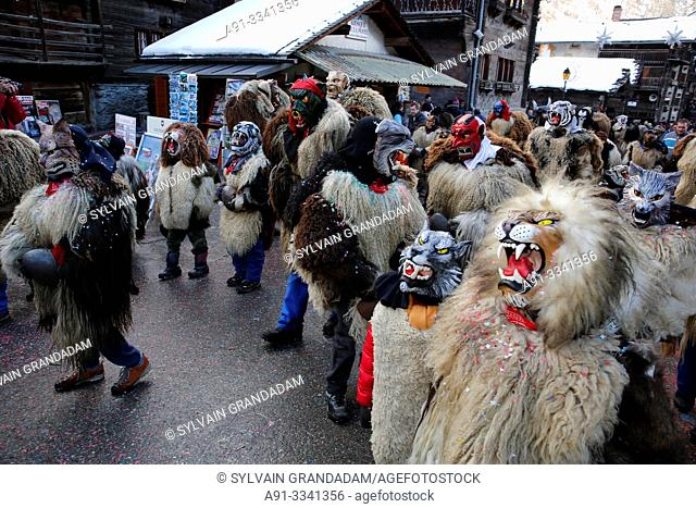 """Switzerland, Valais, Val d'Herens, village of Evolene, Carnaval, """"peluches"""" disguisment of young people and children dressed with a coat made of animal fur and..."""