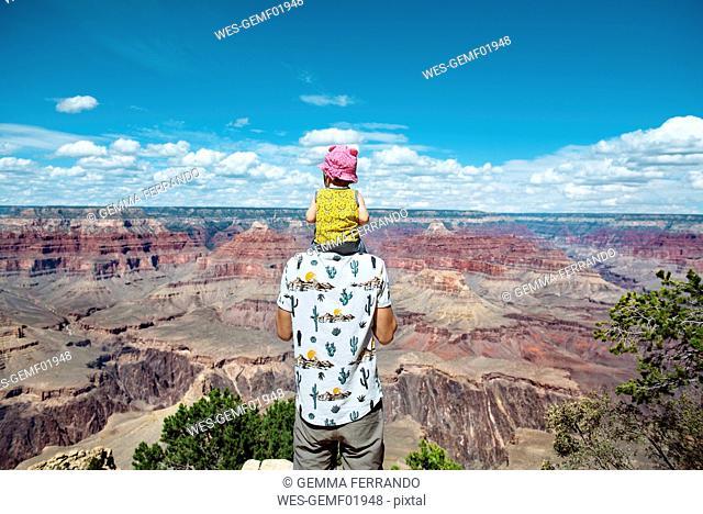 USA, Arizona, Grand Canyon National Park, father and baby girl enjoying the view
