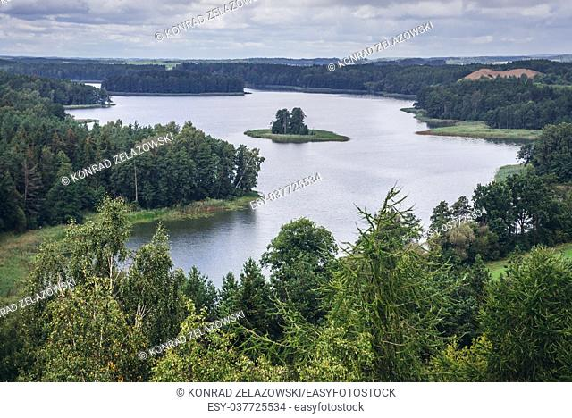 Aerial view of Jedzelewo Lake from lookout tower in Stare Juchy village in Warmian-Masurian Voivodeship of Poland