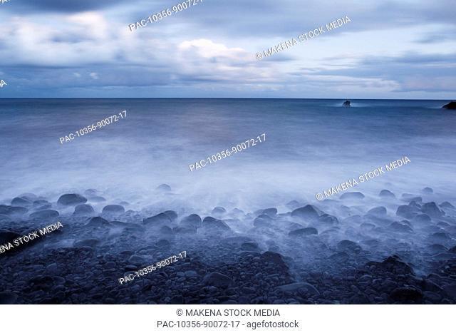 Hawaii, Maui, Kaupo, Rocky ocean shoreline at evening, Long exposure